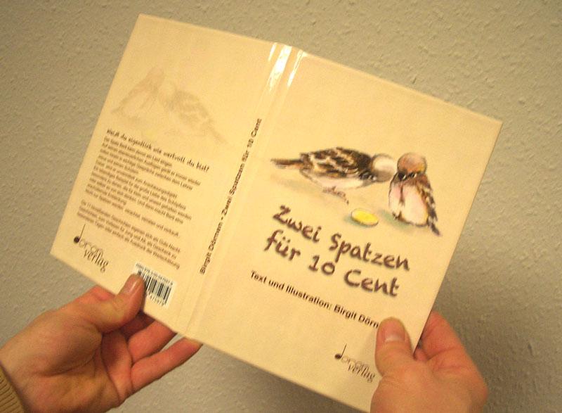 Fertige Buchdecke mit Bezug und Glanzfolienveredelung